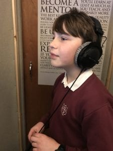 tv commercial voiceover session with child voiceover Sam in the booth taking direction down the line.